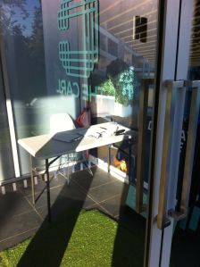 Is this a folding card table being used to welcome visitors into a sales office...why yes, it is!